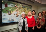 Stitching Sisters in front of the large, 18th Century Tapestry at the opening event Feb. 2012
